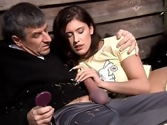 Young Brunette Helps An Older Farmer Have A Good Time